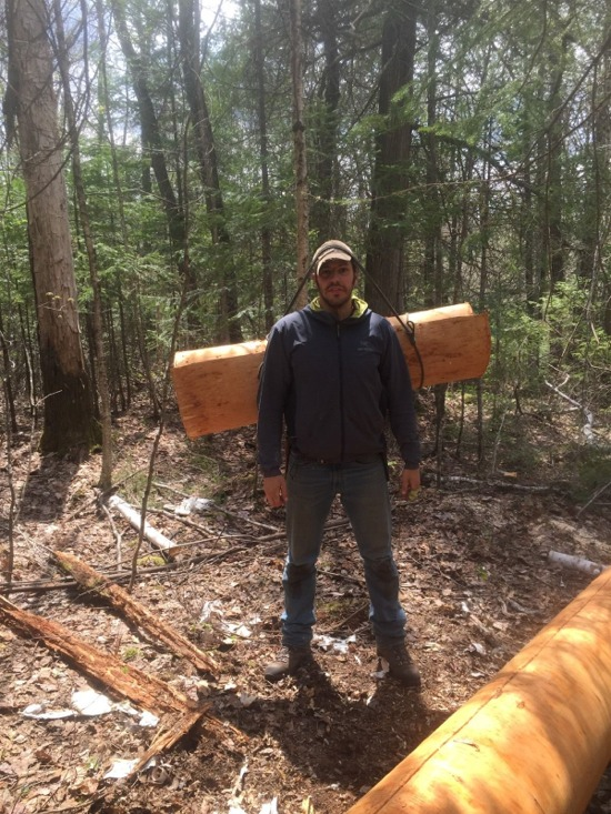 Canoe skin rolled for portage out of forest