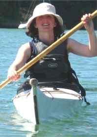 Sea kayaker in summer clothing