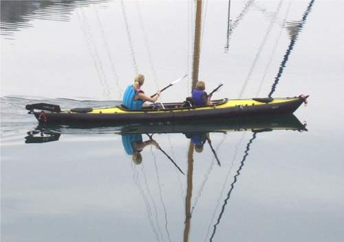 Adult and child in Feathercraft double kayak