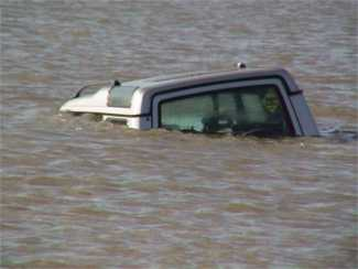 Vehicle covered by rising tide